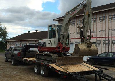 Transport pour pelle mécanique à Trois-Rivières et dans la Mauricie - Conteneur Mobile